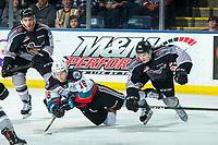 KELOWNA, BC - JANUARY 4: Cole Shepard #16 of the Vancouver Giants checks Michael Farren #16 of the Kelowna Rockets to the ice during third period at Prospera Place on January 4, 2020 in Kelowna, Canada. (Photo by Marissa Baecker/Shoot the Breeze)
