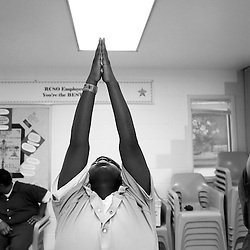 Kyle Green | For The New York Times<br /> 12/17/2012 Female inmates at the Richmond City Jail participate in an ashtanga yoga class led by yoga teacher Robbie Norris (off camera) at the Richmond City Jail. The Richmond City Jail started a yoga program four years ago and is part of a growing trend of yoga participation at correctional institutions throughout the country.