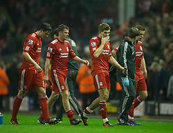 LIVERPOOL, ENGLAND - Tuesday, March 13, 2012: Liverpool's captain Steven Gerrard limps off the pitch with an injury at half-time during the Premiership match against Everton at Anfield. (Pic by David Rawcliffe/Propaganda)