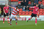Cameron Stewart (27) of Doncaster Rovers takes ball  during the Sky Bet League 1 match between Doncaster Rovers and Peterborough United at the Keepmoat Stadium, Doncaster, England on 19 March 2016. Photo by Ian Lyall.