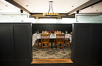 Partitioned seating offers diners a more intimate setting at the Faro Italian Grille in Weirs Beach.  (Karen Bobotas Photographer)