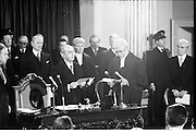 Inaugeration of Cearbhall O'Dalaigh as President  (H77).1974..19.12.1974..12.19.1974..19th December 1974..Following the sudden death of President Erskine Childers, Mr Cearbhall O'Dalaigh was nominated by The Fianna Fail party as its candidate to replace him. The Fine Gael /Labour coalition government did not oppose the nomination and Mr O'Dalaigh was elected un-opposed on a joint party agreement...Image of Mr Cearbhall O'Dalaigh being sworn in as President of Ireland by Chief Justice O'Higgins. Some of those included in the picture are An Taoiseach,Liam Cosgrave, Mr Jack Lynch,Leader Fianna Fail, Mr Conor Cruise-O'Brien TD and justin Keating TD>