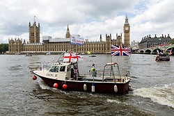 © Licensed to London News Pictures. 15/06/2016. LONDON, UK.  Fishing boats take part in a Vote Leave flotilla outside Parliament in Westminster on the River Thames. Nigel Farage led a pro-Brexit flotilla of fishing vessels along the River Thames to Westminster today, urging people to vote leave in the European Referendum.  Photo credit: Vickie Flores/LNP