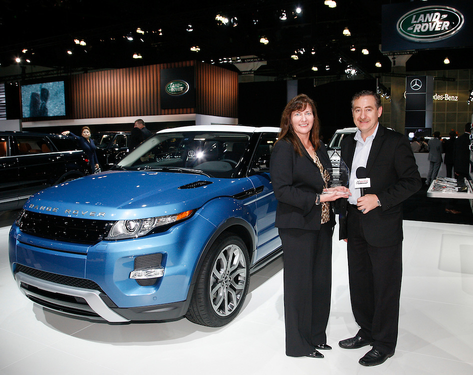 Kim McCullough, Brand Vice President, Land Rover North America receives the Hispanic Motor Press Award for the 2012 Range Rover Evoque from Ricardo Rodriguez-Long of AutoAFondo.com at the Los Angeles Auto Show on November, 16, 2011.