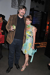 STEPHEN FRY and KATHY LETTE at a party to celebrate the publication of Joseph Anton by Sir Salman Rushdie held at The Collection, 264 Brompton Road, London SW3 on 14th September 2012.