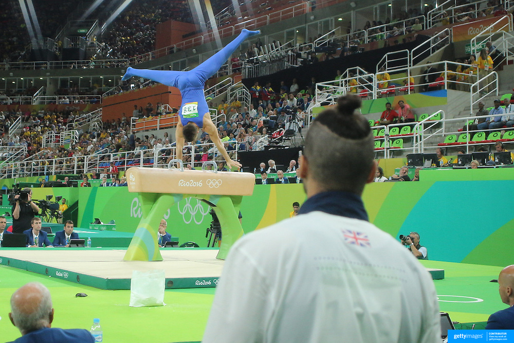 Gymnastics - Olympics: Day 9 Louis Smith of Great Britain watches Max Whitlock of Great Britain perform his routine in the Men's Pommel Horse Final at the Rio Olympic Arena on August 14, 2016 in Rio de Janeiro, Brazil. (Photo by Tim Clayton/Corbis via Getty Images)
