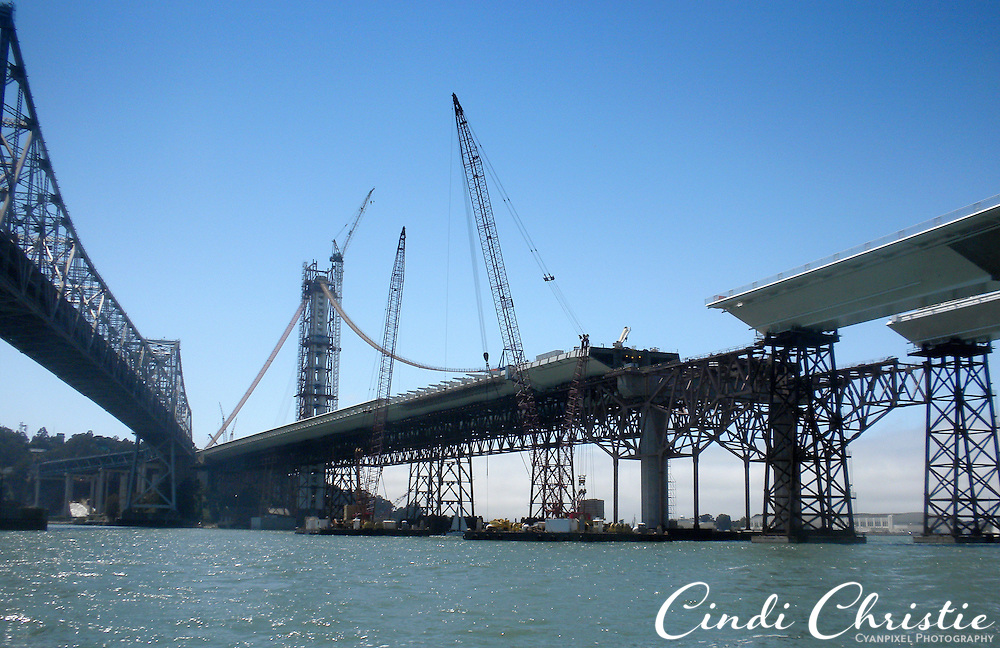 Gaps remain in the new eastern span of the San Francisco-Oakland Bay Bridge, right,  still under construction in Oakland, Calif., on Saturday, Aug. 6, 2011. A catwalk will be used for stringing cable on the self-anchored suspension span.  (© 2011 Cindi Christie/Cyanpixel Photography)