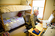"""Ron Grassi works on a legal brief in his Tahoe City, Calif. """"war room""""/guest bedroom May 13, 2010. Grassi is suing the big three ratings agencies after he lost $40,000 on a Lehman Brothers bond."""
