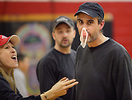 Middletown, New York - A man blows a bubble with gum during a contestat Family Night at the Middletown YMCA on April 2, 2011.