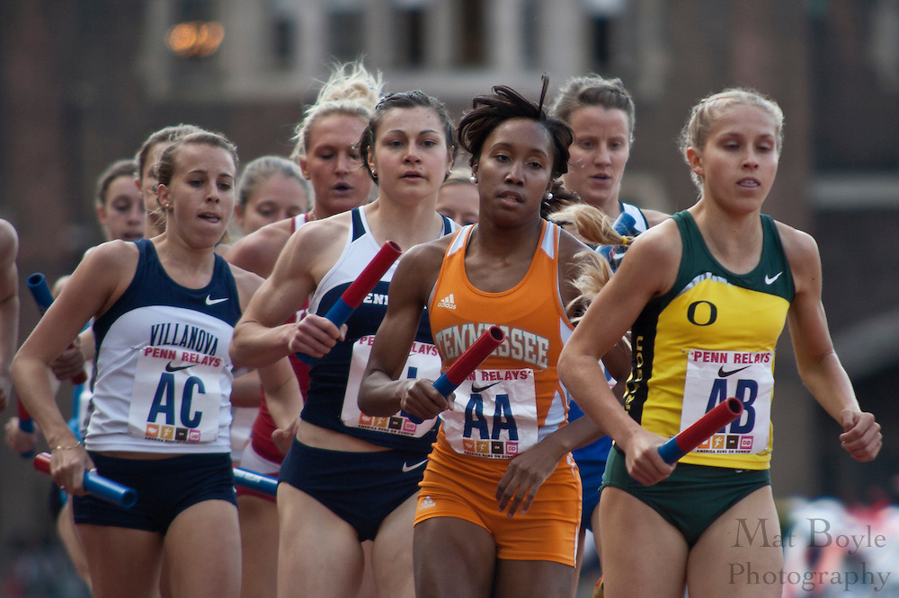 Competitors run the back straight away during the College Women's Distance Medley Championship of America at Fraklin Field at the 2010 Penn Relays. Tennessee won the event with a time of 10:54.65. Also pitcured, Oregon and VIllanova placed second and third respectivly.