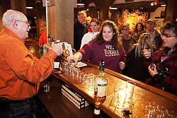 Buffalo Trace employee Fred Mozenter, left, gives a tasting of manufactured spirits to patrons of the first of what will be regular ghost tours at the oldest distilling site in the U.S., Thursday, Nov. 17, 2011 at Buffalo Trace Distillery  in Frankfort. Photo by Jonathan Palmer