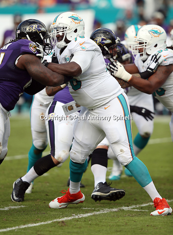 Miami Dolphins offensive tackle Branden Albert (76) blocks during the 2015 week 13 regular season NFL football game against the Baltimore Ravens on Sunday, Dec. 6, 2015 in Miami Gardens, Fla. The Dolphins won the game 15-13. (©Paul Anthony Spinelli)