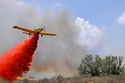 Aircraft drops fire retardant on a fire caused by Palestinian Kite bombs that were flown from Gaza with a lit petrol soaked cloth, to set fires to Israeli fields and crops. Photographed on July 13, 2018 on the Israel Palestine (Gaza) Border