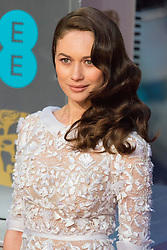 © Licensed to London News Pictures. 14/02/2016. London, UK. OLGA KURYLENKO arrives on the red carpet at the EE British Academy Film Awards 2016 Photo credit: Ray Tang/LNP