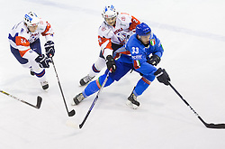 Anze Kuralt and Gal Koren of Slovenia vs Diego Kostner of Italy during Friendly Ice-hockey match between National teams of Slovenia and Italy on April 5, 2013 in Ice Arena Tabor, Maribor, Slovenia. (Photo By Vid Ponikvar / Sportida)