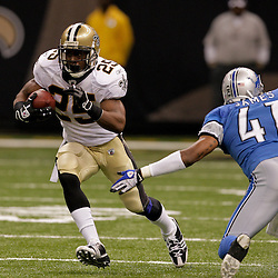 2009 September 13: New Orleans Saints running back Reggie Bush (25) runs past Detroit Lions cornerback William James (41) during a 45-27 win by the New Orleans Saints over the Detroit Lions at the Louisiana Superdome in New Orleans, Louisiana.