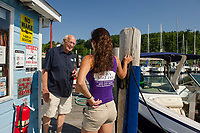 Merrill Fay and Kaitlyn Marcella at the gas docks in Fay's Boat Yard on Lake Winnipesaukee.  (Karen Bobotas/for New England Boating)
