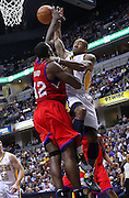 March 14, 2012; Indianapolis, IN, USA; Indiana Pacers shooting guard Dahntay Jones (1) shoots the ball against Philadelphia 76ers power forward Elton Brand (42) at Bankers Life Fieldhouse. Indiana defeated Philadelphia 111-94. Mandatory credit: Michael Hickey-US PRESSWIRE