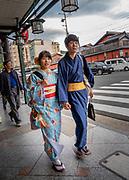 Kimono clad couple in Gion district, Kyoto, Japan.