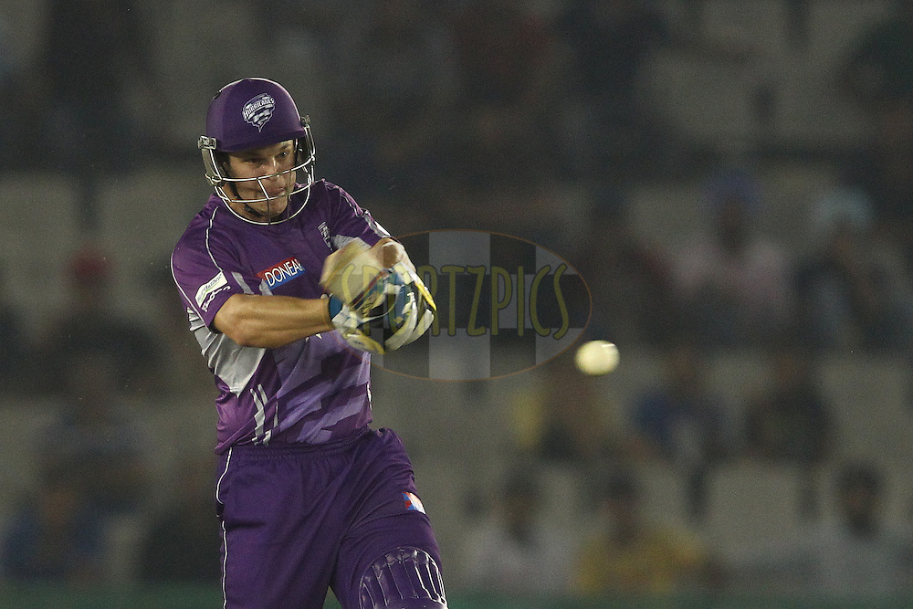 Evan Gulbis of the Hobart Hurricanes attacks a delivery during match 2 of the Oppo Champions League Twenty20 between the Kings XI Punjab and the Hobart Hurricanes held at the Punjab Cricket Association Stadium, Mohali, India on the 18th September 2014<br /> <br /> Photo by:  Shaun Roy / Sportzpics/ CLT20<br /> <br /> <br /> Image use is subject to the terms and conditions as laid out by the BCCI/ CLT20.  The terms and conditions can be downloaded here:<br /> <br /> http://sportzpics.photoshelter.com/gallery/CLT20-Image-Terms-and-Conditions-2014/G0000IfNJn535VPU/C0000QhhKadWcjYs