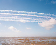 Hawk jets of the Red Arrows, Britain's RAF aerobatic team display over beach using quad bikes as display datum (centre).