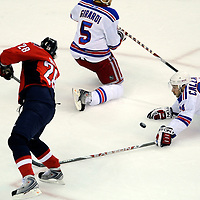 28 April 2009:   Washington Capitals left wing Alexander Semin (28) scores a goal as the puck ricochets off of New York Rangers right wing Ryan Callahan (24) in the 1st period in the seventh game of the Eastern Conference NHL quarterfinal playoff game at the Verizon Center in Washington, D.C.  The Washington Capitals defeated the New York Rangers 2-1 in the Eastern Conference NHL quaterfinal playoff to advance to the second round of the playoffs.