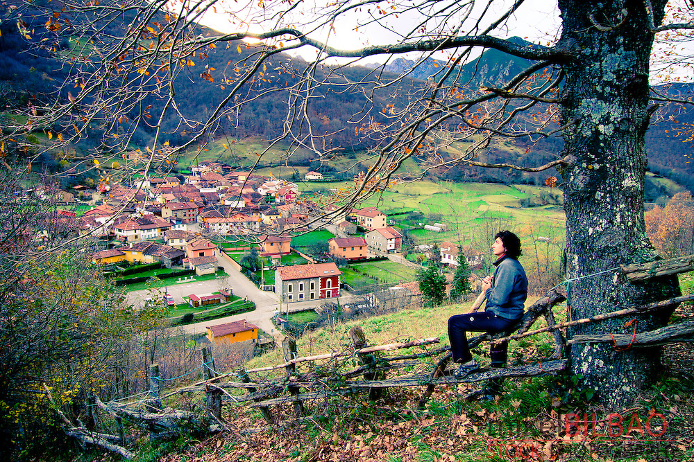 Woman and landscape. Bezanes. Redes Natural park. Asturias. Spain.