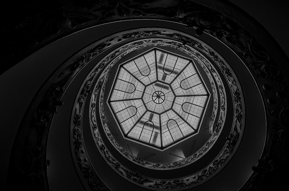 Spiral staircase from below with dome light