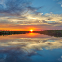 South Florida sunset photography from outdoor photographer Juergen Roth showing the edge of the Arthur R. Marshall Loxahatchee National Wildlife Refuge located west of Boynton Beach in Palm Beach County, FL. Arthur R. Marshall Loxahatchee National Wildlife Refuge is an amazing area for viewing wildlife and photography in Florida. <br />