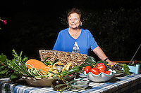 PIOPPI (POLLICA), ITALY - 5 OCTOBER 2016: Delia Morinelli (79) poses for a portrait in front of local vegetables, fruits and olive oil in the terrace of her home, which recently opened to the public for lunch and dinner in Pioppi, a hamlet in the municipality of Pollica, Italy, on October 5th 2016. Starting in the 60's, Delia Morinelli was the cook of Ancel Keys, the American scientist who studied the influence of diet on health and the promoter of the Mediterranean Diet.<br /> <br /> To understand how people can live longer throughout the world, researchers at University of California, San Diego School of Medicine have teamed up with colleagues at University of Rome La Sapienza to study a group of 300 citizens, all over 100 years old, living in Acciaroli (Pollica), a remote Italian village nestled between the ocean and mountains in Cilento, southern Italy.<br /> <br /> About 1-in-60 of the area's inhabitants are older than 90, according to the researchers. Such a concentration rivals that of other so-called blue zones, like Sardinia and Okinawa, which have unusually large percentages of very old people. In the 2010 census, about 1-in-163 Americans were 90 or older.