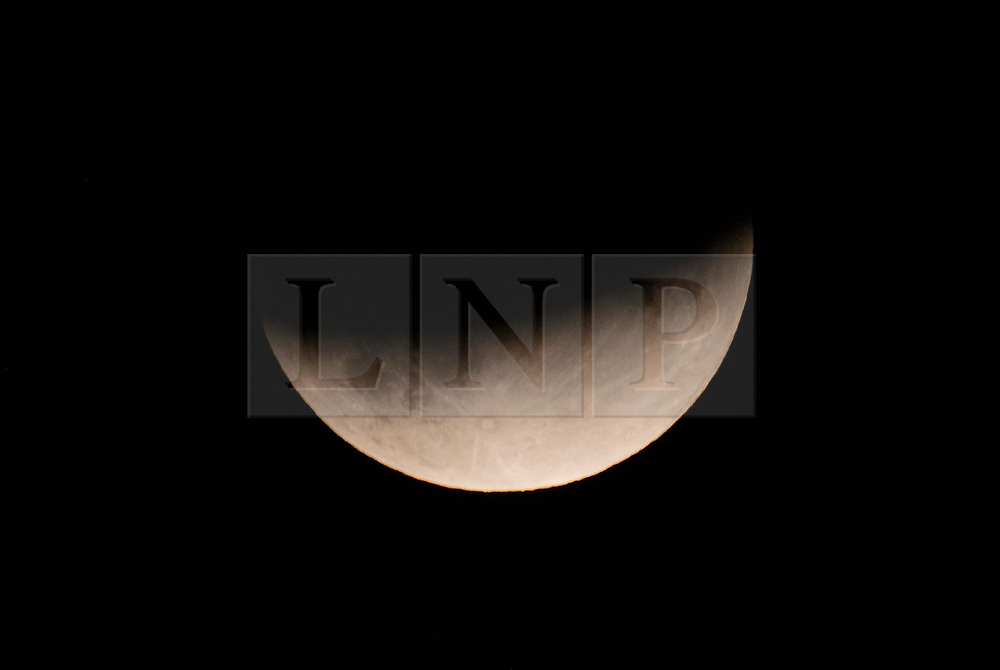 © Licensed to London News Pictures. 16/07/2019. London, UK. July's full moon, known as the 'Buck Moon', rises over central London during a partial lunar eclipse. The eclipse occurs on the 50th anniversary of the launch of NASA's Apollo 11 mission to place men on the moon's surface in July 1969. Photo credit: Peter Macdiarmid/LNP