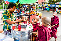 YANGON, MYANMAR - DECEMBER 16, 2016 : Buddhist monk children students buying ice cream Yangon (Rangoon) in Myanmar (Burma)