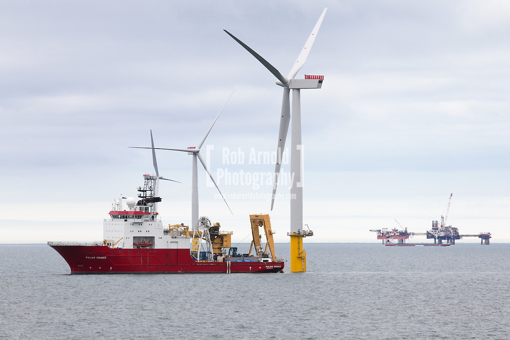 © Rob Arnold.  04/04/2014. North Wales, UK. A view of the cable lay vessel, Polar Prince, working on Gwynt y Môr Offshore Wind Farm off the coast of North Wales. Photo credit : Rob Arnold