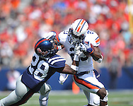 Auburn running back Onterio McCalebb (23) is tackled by Ole Miss defensive back Mike Hilton (28) at Vaught-Hemingway Stadium in Oxford, Miss. on Saturday, October 13, 2012. (AP Photo/Oxford Eagle, Bruce Newman)..