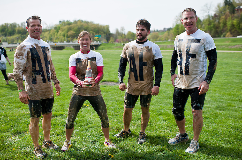 David Tompkins, left to right, Marissa Higgens, Andrew Tompkins, and Mike Higgens celebrate after finishing the O'Bleness Health System Mud Run, Saturday, April 27, 2013. Their run and t-shirts stood for the initials of Angie Fenton, a journalist based out of Louisville. Race for a Reason, Race 4 A Reason, Annual Events, Events, Students, Faculty & Staff