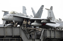July 28, 2017 - Portsmouth, Hampshire, UK - The F-18 Hornet fighter aircraft  on board the USS George H.W. Bush (CVN 77) aircraft carrier as it anchors in Stokes Bay near Portsmouth Harbour ahead of a training exercise with British troops. The nuclear-powered behemoth can carry up 80 aircraft on its four-and-a-half acre flight deck, as well as 5,000 Navy personnel and aircrew. (Credit Image: © Jason Bryant/London News Pictures via ZUMA Wire)