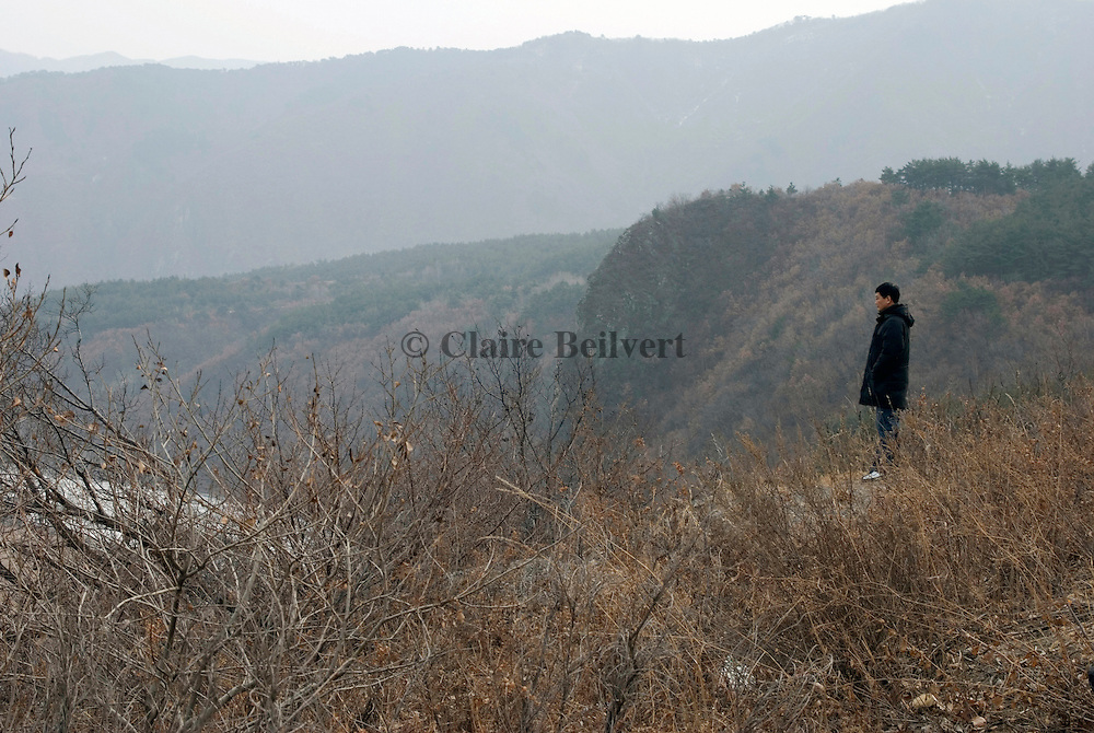 A North Korean defector near Tumen in China, staring at his country across the frozen Tumen river. He escaped his country a first time in 1986, was caught by the Chinese police and sent back to North Korea where he was condemned to five years in the infamous Yodok labour camp. He escaped again to China in 1997, and finally arrived in South Korea in 2001. He often comes back to China to help fellow defectors to reach South Korea.