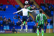 Bolton Wanderers striker Gary Madine (14)  is beaten in the air by AFC Wimbledon defender Will Nightingale (5)  during the EFL Sky Bet League 1 match between Bolton Wanderers and AFC Wimbledon at the Macron Stadium, Bolton, England on 4 March 2017. Photo by Simon Davies.
