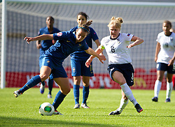 LLANELLI, WALES - Saturday, August 31, 2013: England's Sherry McCue in action against France's Ghoutia Karchouni during the Final of the UEFA Women's Under-19 Championship Wales 2013 tournament at Parc y Scarlets. (Pic by David Rawcliffe/Propaganda)