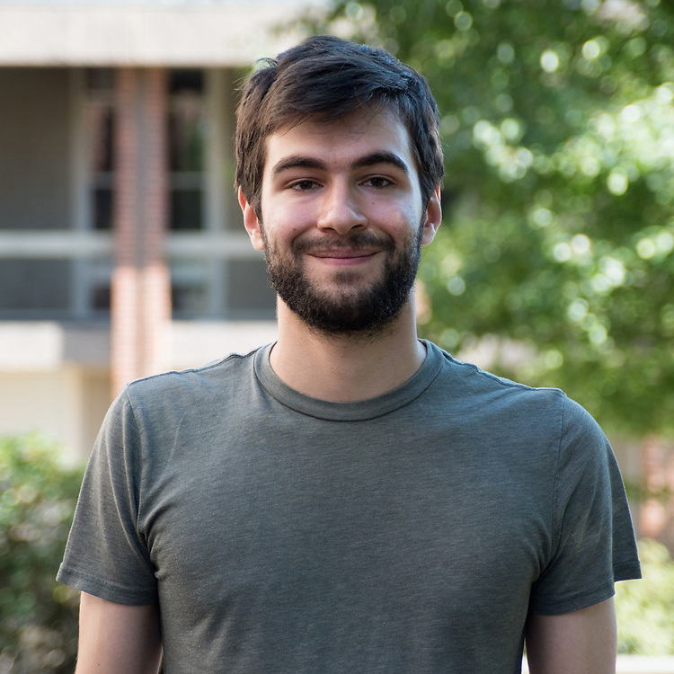 Executive Op/Ed editor Arman Smigleski poses for a portrait on September 23. ( Seohyun Shim / The Tufts Daily )