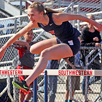 Southwestern's Lauren Swan en route to winning the 100 meter hurdles 4-20-16 photo by Mark L. Anderson