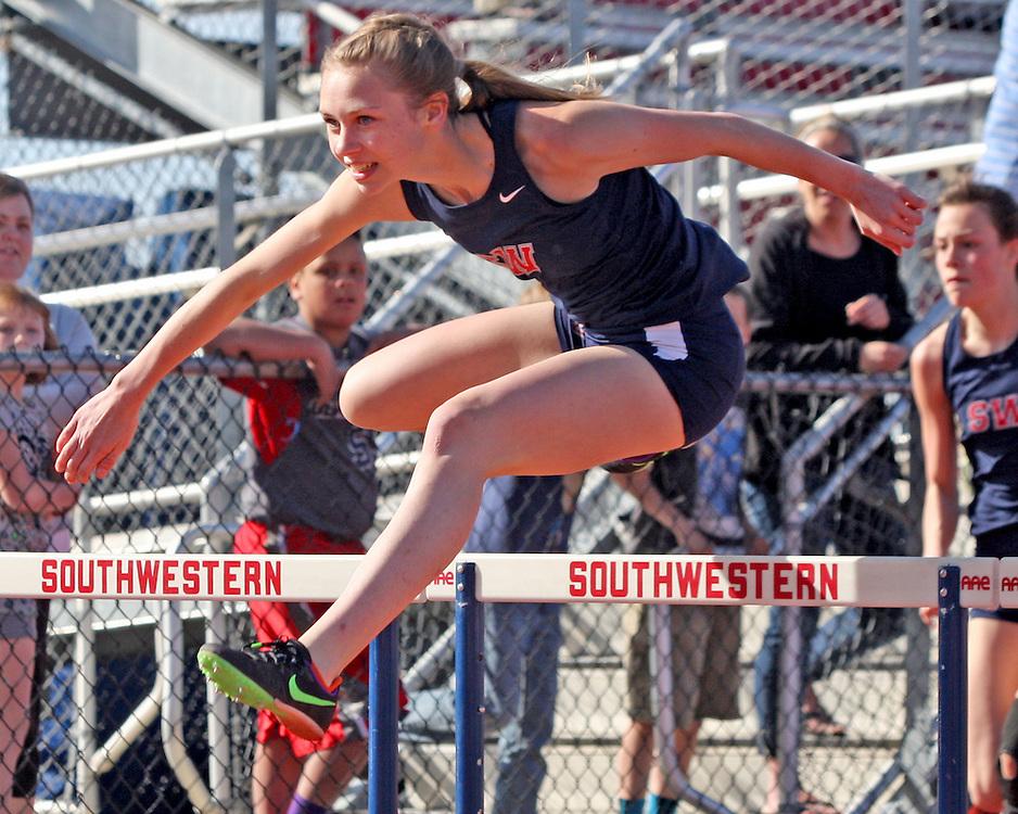 Southwestern's Lauren Swan en route to winning the 100 meter hurdles 4-20-16 photo by Mark L. Anderson