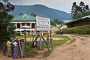 Elderly patients arriving at the gates of Bwindi Community hospital, Uganda. The hospital is in the town of Buhoma on the edge of Bwindi Impenetrable forest. It serves approximately 150,000 people in the area. Buhoma is one of Uganda's remotest towns, just 2 kilometres from the boarder with the Democratic Republic of Congo. A four-hour drive to the nearest tarmac covered road.