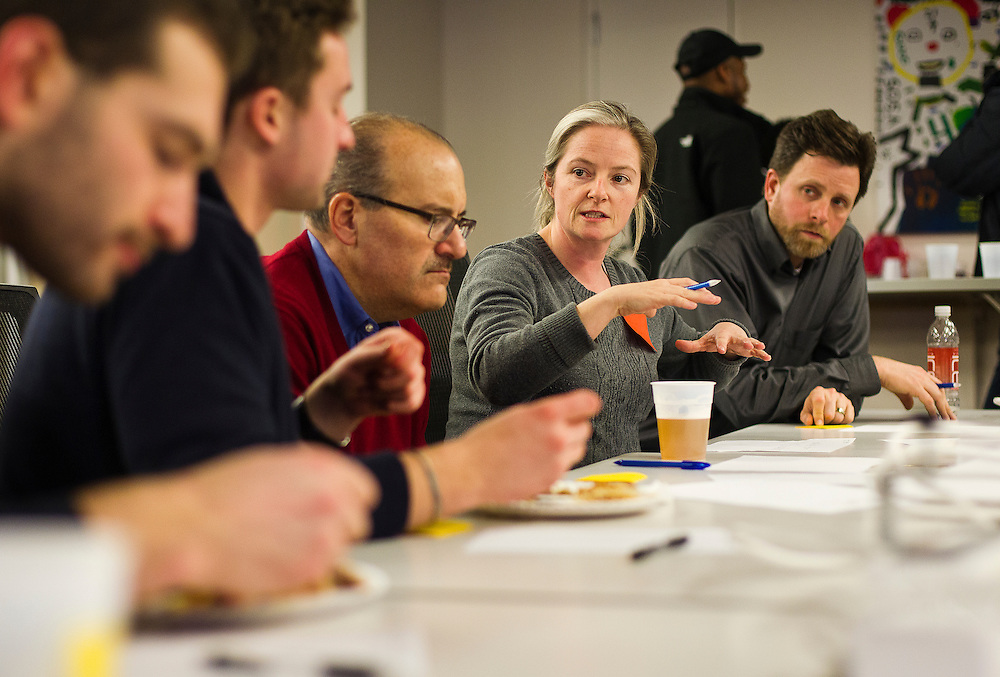"""Meghan Blake-Horst, center, discusses issues affecting Madison food cart regulations during the 100state """"Problem Solving Soirée"""" on January 11, 2017. The event kicked off the opening of the entrepreneurial coworking space on the 6th floor of 316 West Washington Avenue in Madison."""