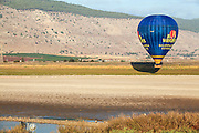 Hot air balloon photographed in the Jezreel Valley, Israel Mount Gilboa in the background