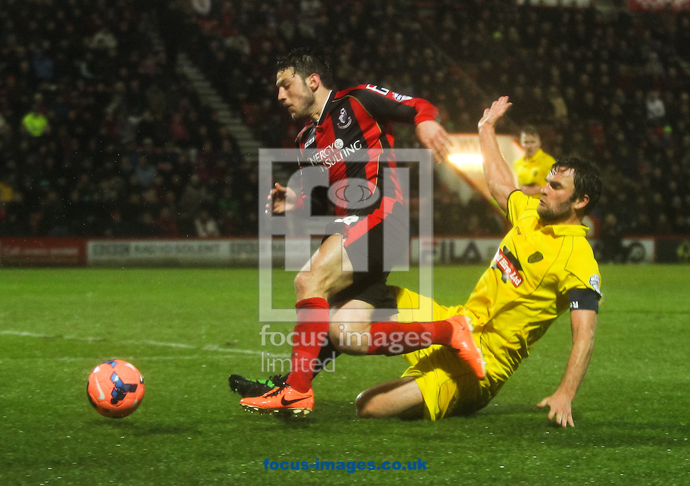 Picture by Tom Smith/Focus Images Ltd 07545141164<br /> 14/01/2014<br /> Harry Arter (left) of Bournemouth wins a penalty for his team after he is fouled in the box by Ian Sharps (right) of Burton Albion during the The FA Cup match at the Goldsands Stadium, Bournemouth.