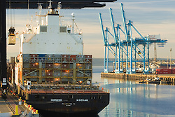 Cranes and container ship at Port of Tacoma, Tacoma, Washington, United States