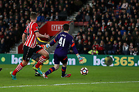 Football - 2016 / 2017 FA Cup - Fourth Round: Southampton vs. Arsenal<br /> <br /> Danny Welbeck of Arsenal nips in to poke the ball past Southampton's Harry Lewis to score his second goal at St Mary's Stadium Southampton England<br /> <br /> COLORSPORTt/SHAUN BOGGUST