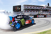 KEN BLOCK, USA - SHOW act in a Ford <br /> V8 Supercars. Clipsal 500. Adelaide Parklands Circuit.<br /> Adelaide. Australia. Friday 1/3/2013.copyright: &copy; ATP Damir IVKA<br />  - <br /> V8 Tourenwagen Rennen in Adelaide, Australien - 2013,  v8 Saloon car race named Clipsal 500 - Honorarpflichtiges Foto, Fee liable image, Copyright &copy; ATP Damir IVKA
