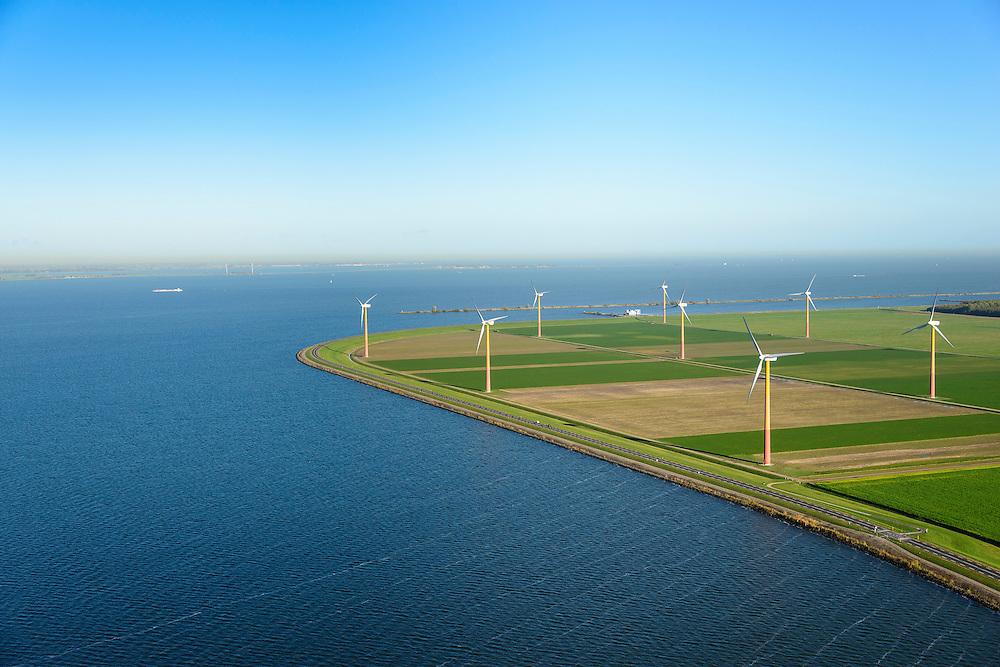 Nederland, Flevoland, Gemeente Almere, 24-10-2013; Almere-Pampus, Kustzone Almere. Zicht op Muiderhoek en Pampushaven, locatie voor een mogelijke IJmeerverbinding (IJmeerlijn). Foto richting Markermeer, MArken aan de horizon.  Windmills along the coast in Almere Poort, viewed in direction Markermeer.<br /> luchtfoto (toeslag op standaard tarieven);<br /> aerial photo (additional fee required);<br /> copyright foto/photo Siebe Swart.